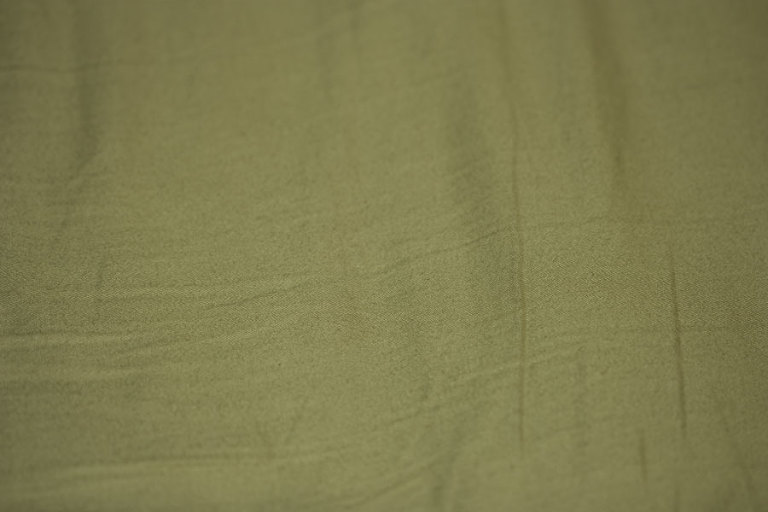 Rumpled Sheet - Thumbnail of a subdued olive green digital texture of fabric texture