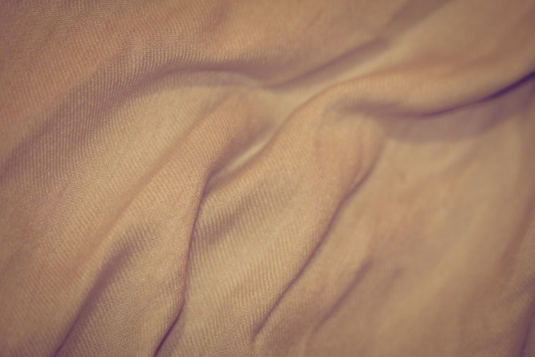 Pashmina Pink – Thumbnail of a soft peachy pink fabric texture with a slight sheen