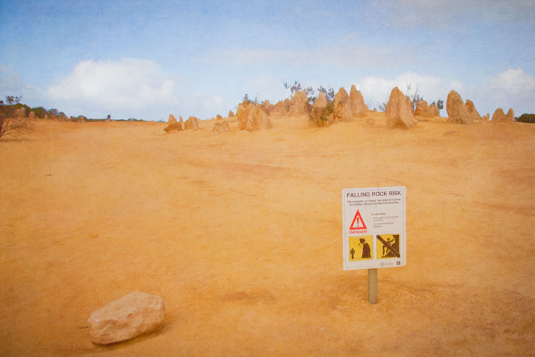 Sign warning of Falling Rock Risk in the Pinnacles Desert, Nambung National Park