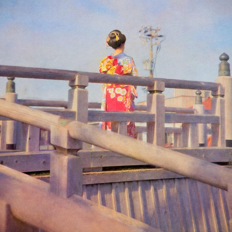 Young woman wearing traditional kimono and hair style on Naka-no Hash Bridge in Kazue Machi Chaya District