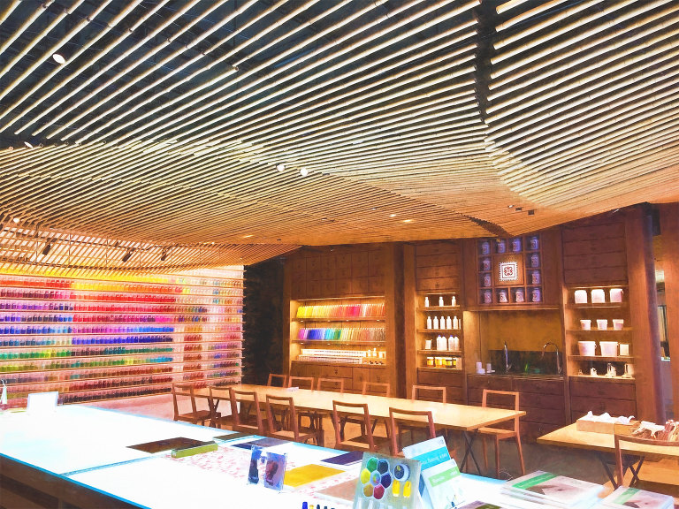 Pigment store ceiling and tables in front of shelves